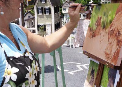 lady painting bears
